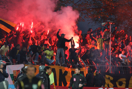 Botev Plovdiv's fans celebrate the first goal against Litex Lovetch during their Bulgarian National Cup semi-final soccer match in the city of Lovetch
