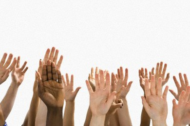 A Large Group of Raised Hands